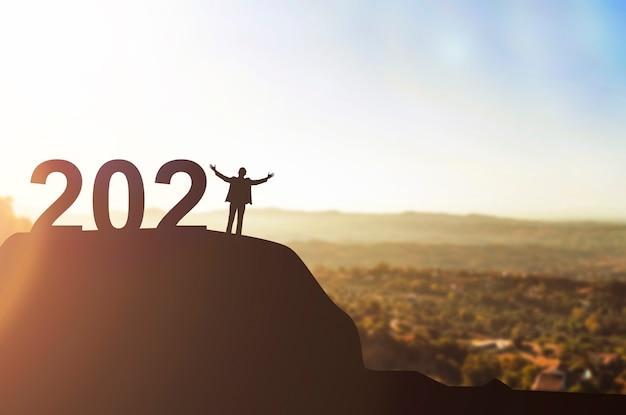새 해를 축 하하는 기업들의 실루엣입니다. 2021 년 새해 복 많이 받으세요 프리미엄 사진