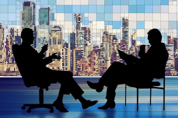 会議を持つ2人のビジネスマンのシルエット 無料写真