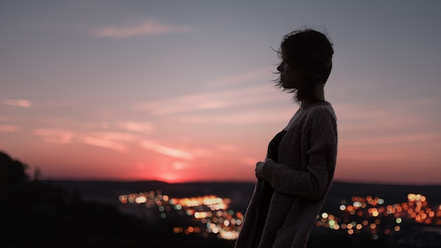 silhouette of woman with a city background premium photo