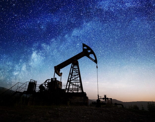 Silhouette of oil pump jack working in the night Premium Photo