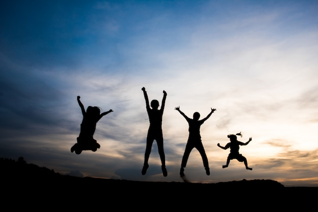 Silhouette of people happy time Free Photo