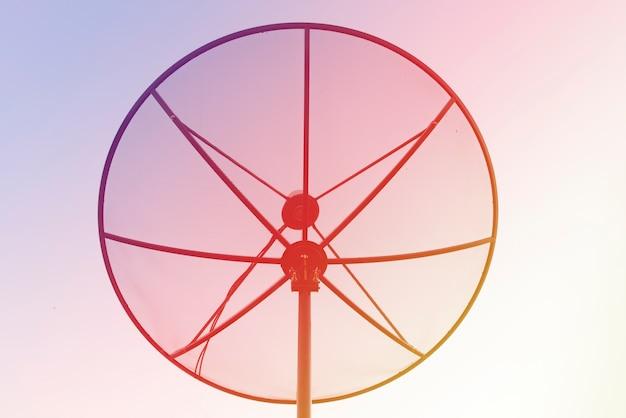 Silhouette satellite dish bright light.nature background. Premium Photo