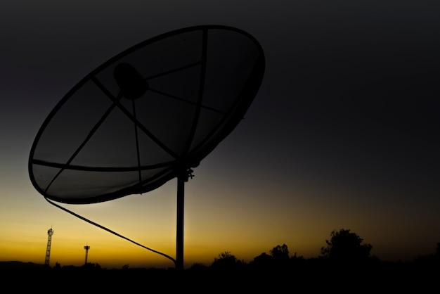 Silhouette satellite dish communication technology network Premium Photo