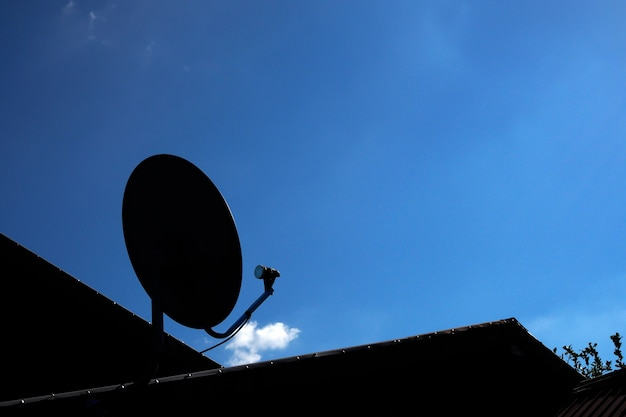 Silhouette of satellite dish with blue sky Premium Photo