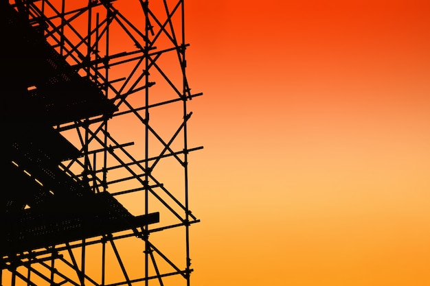 Silhouette of scaffolding on sunset sky Premium Photo