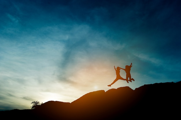 Silhouette of team leadership, teamwork and teamwork and delightful silhouette concepts Premium Photo
