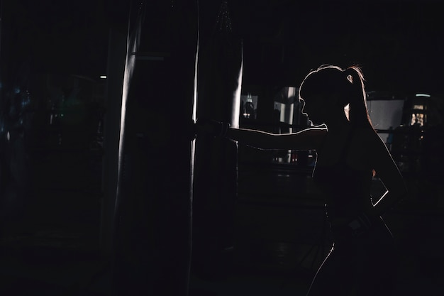 Silhouette of woman boxing Free Photo
