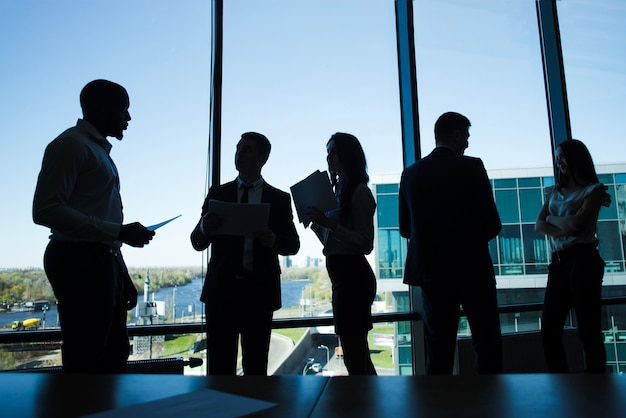 Silhouettes of business people Free Photo