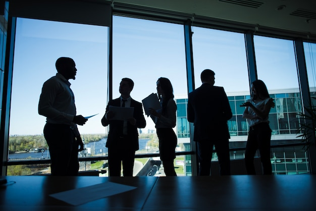 Silhouettes of business team Free Photo