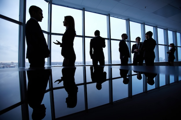 Silhouettes of businesspeople Free Photo