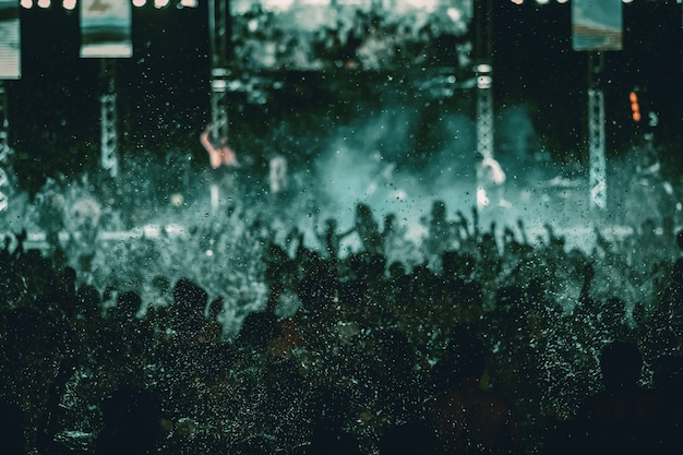 Silhouettes of concert crowd in front of bright stage lights, pool party Premium Photo