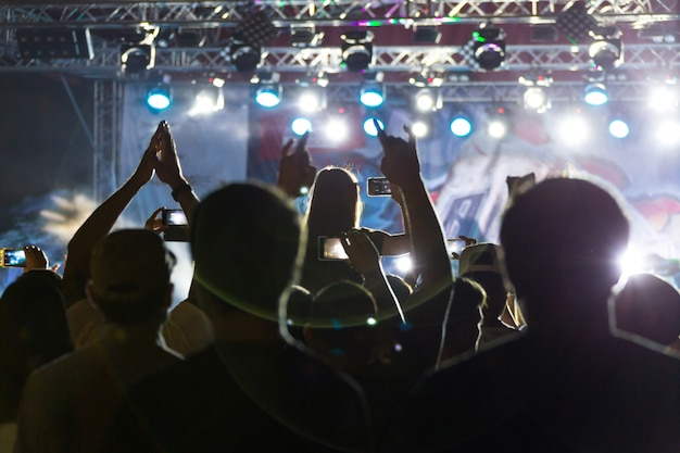Silhouettes of crowd at concert near stage Premium Photo