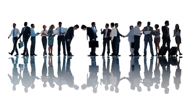 Silhouettes of diverse business people working Premium Photo