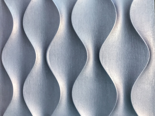 Silver 3d interior decorative wall panel with unusual geometric shape. Premium Photo