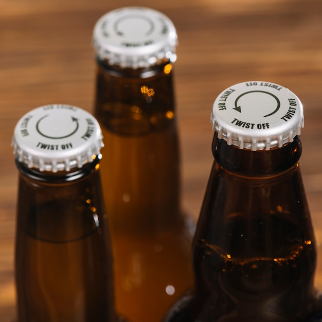 Silver cap on beer bottle Free Photo