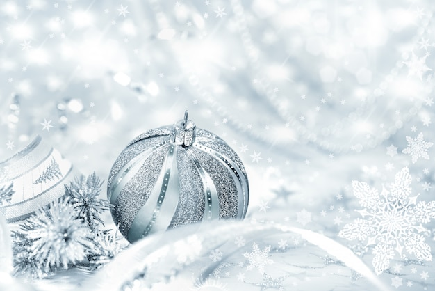 Silver christmas bauble on abstract Premium Photo