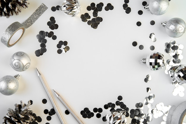 Silver december elements with copy space background Free Photo