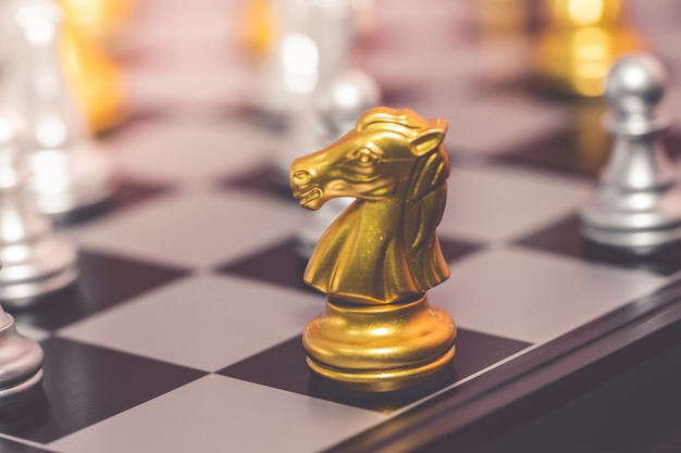 Silver and gold chess set for business concept Premium Photo