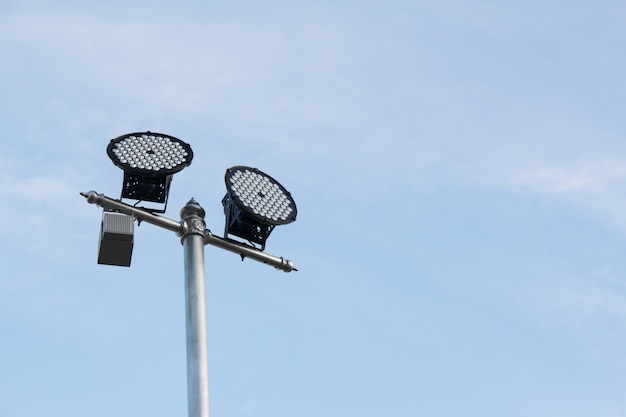 Silver lamp post with a light led bulb on the left side Premium Photo