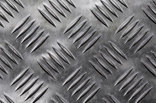 환기 구멍이있는 실버 메탈릭 배경 무료 사진