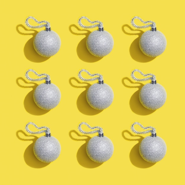 2021 Christmas Toy Trend Premium Photo Silver New Years Balls Holiday Toy On Yellow Christmas Greeting Card Minimal Style Trend Color Of 2021 Year