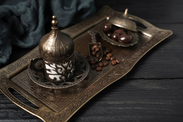 Silver plate with turkish cup of coffee Free Photo