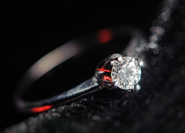 Silver ring on a black background. macro picture Premium Photo
