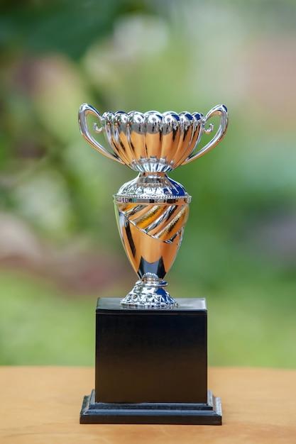 Silver trophy on bokeh light background Premium Photo