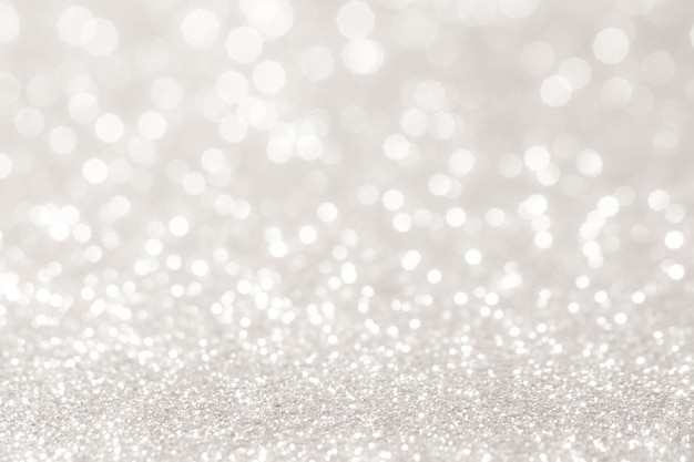 Silver and white bokeh lights defocused. abstract background Premium Photo