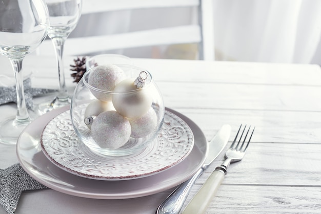 Silver And White Christmas Table Setting With Christmas Decorations