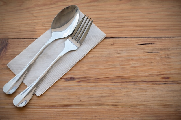 dinner table background. Silverware, Fork Spoon And Paper Put On Wooden Dining Table Set In Left Hand Focused Dinner Background