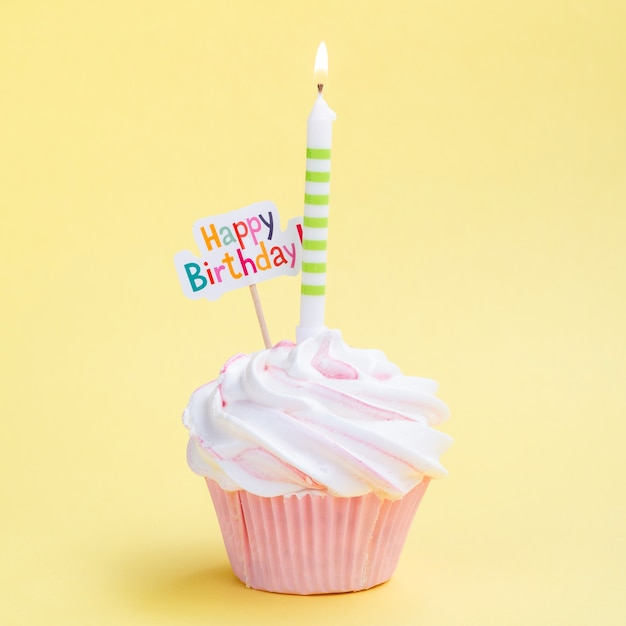 Simple birthday muffin with candle Free Photo