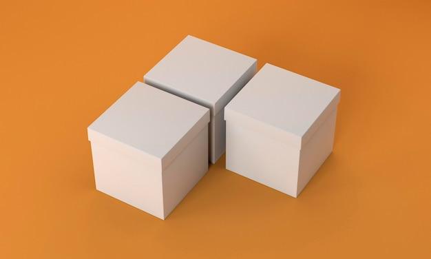 Scatole di cartone semplici su sfondo arancione Foto Gratuite