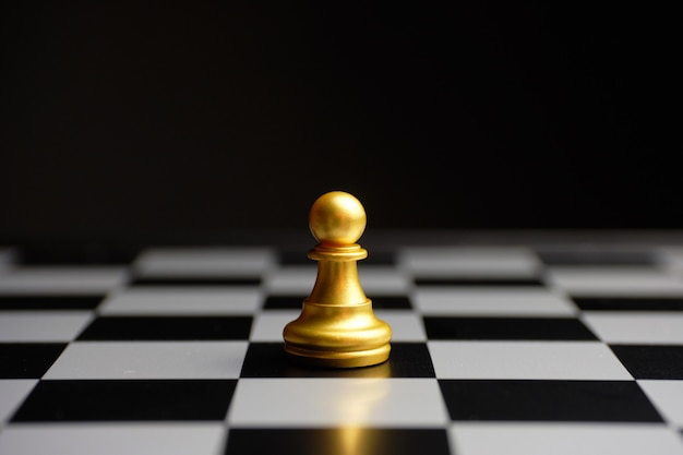 Simple chess piece pawn on a board Premium Photo
