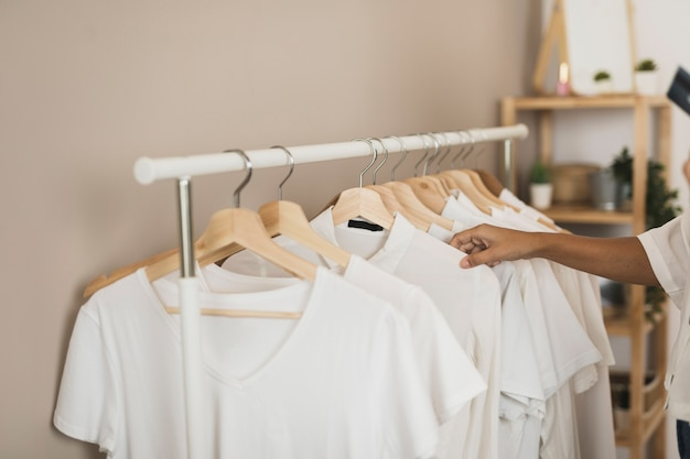 Simple wardrobe with white t-shirts Free Photo