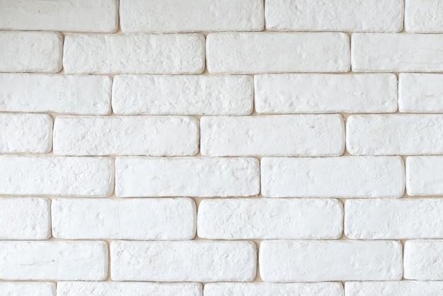 Simple white brick wall background Free Photo