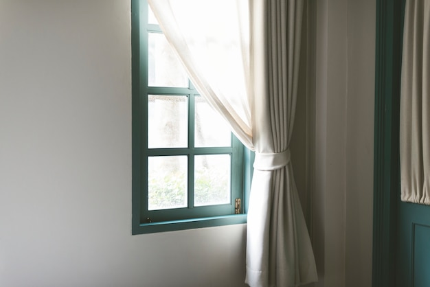 Simple window with white curtain Free Photo