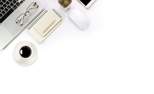 Simple workspace technology white table and laptop computer Premium Photo