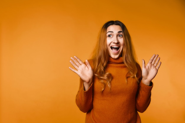Sincerely laughing redhead caucasian woman dressed in wool pullover Free Photo
