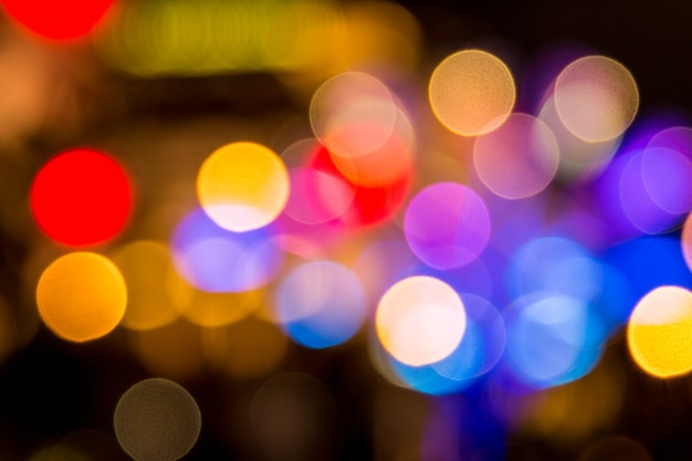 Singapore city night lights bokeh blurred background Photo