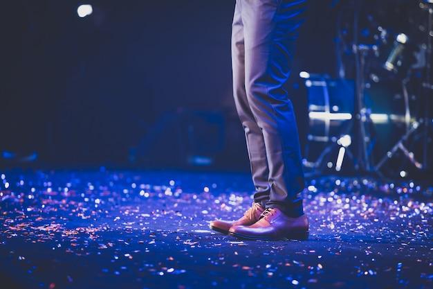 Singer on stage background Premium Photo