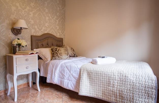 Single bedroom of the ares hotel Premium Photo