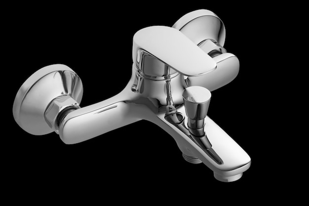 Single lever bath mixer. short nose. isolated over black background. wall mounted. Premium Photo