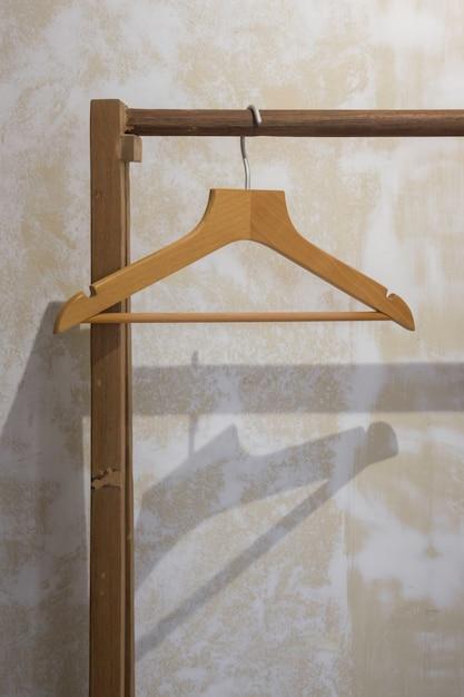 Single wooden hanger on pole Premium Photo