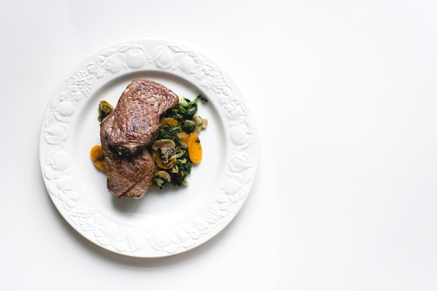 Sirloin beef steak with vegetables Free Photo