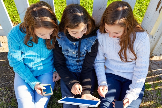 Sister girls friends having fun with technology Premium Photo