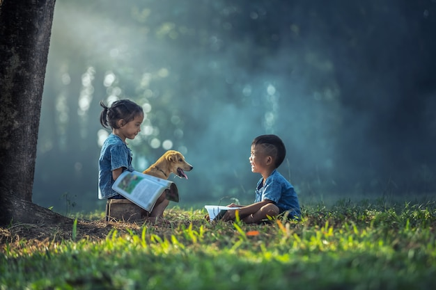 Sister taking tutoring courses with brother at outdoor Premium Photo