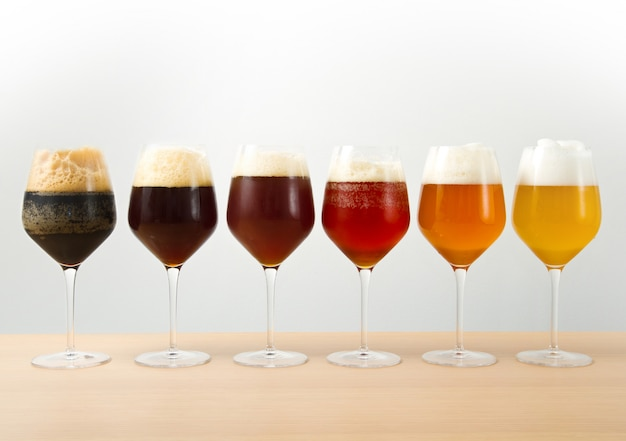 Six glasses with different beers Premium Photo