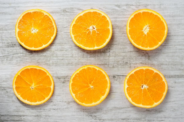 Six slices of fresh oranges on white wood Premium Photo