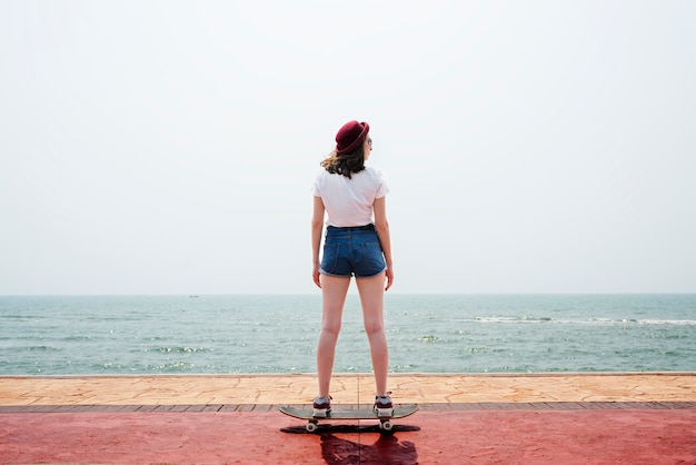 Skateboard recreational pursuit summer beach holiday concept Free Photo